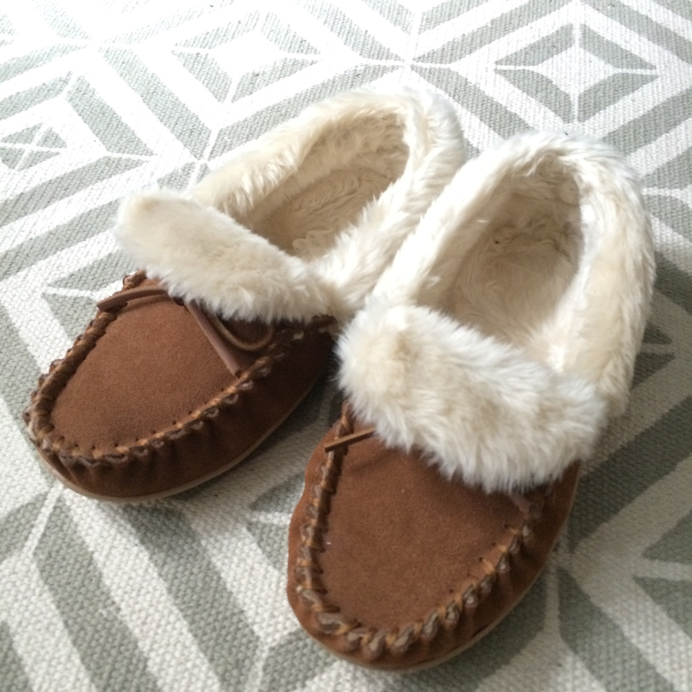 these oh-so-cozy  moccasins , which keep my feet warm at my desk.