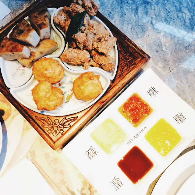 a taiwanese snack platter with tasty sauces handily labeled for your eating pleasure.