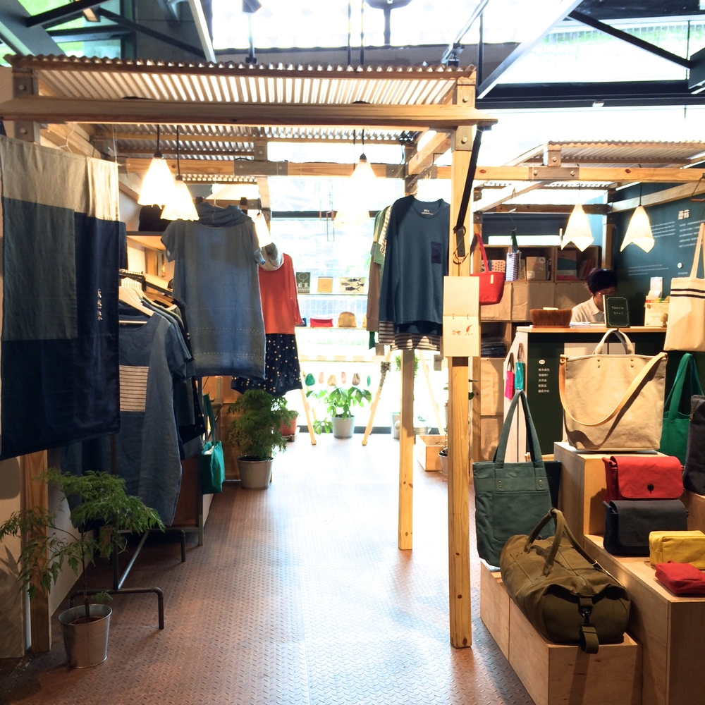 one of the independent clothing and textile vendors on the first level.