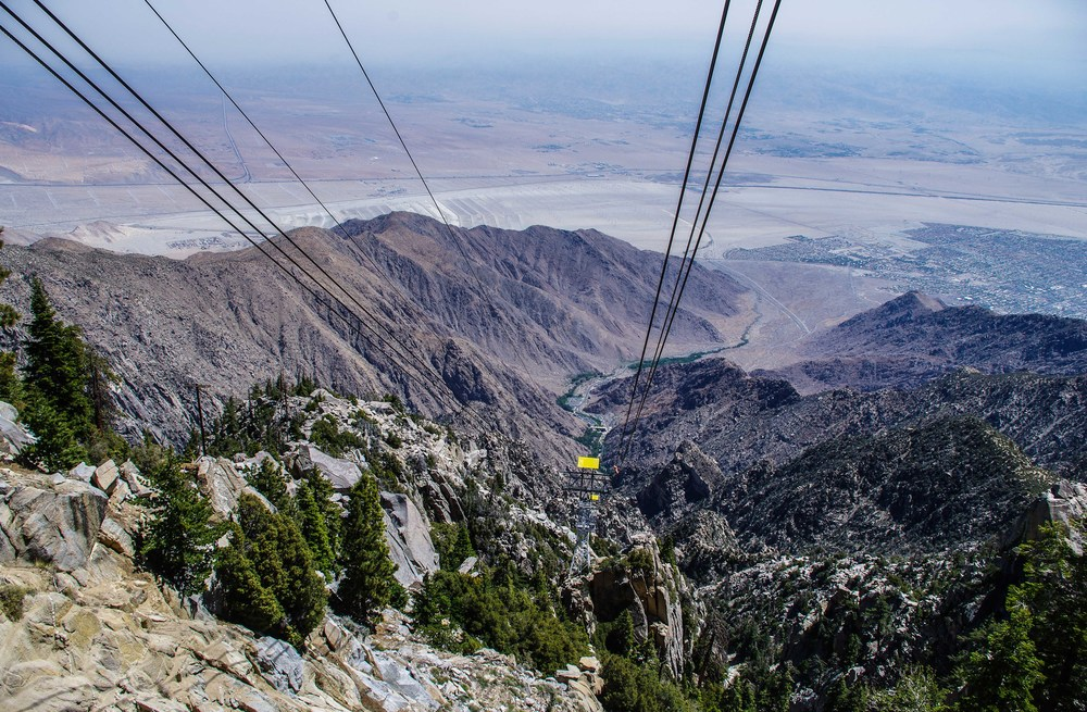 The Palm Springs Aerial Tramway whisks visitors from the hot desert floor to a lush alpine respite in fifteen minutes. Palm Springs, California