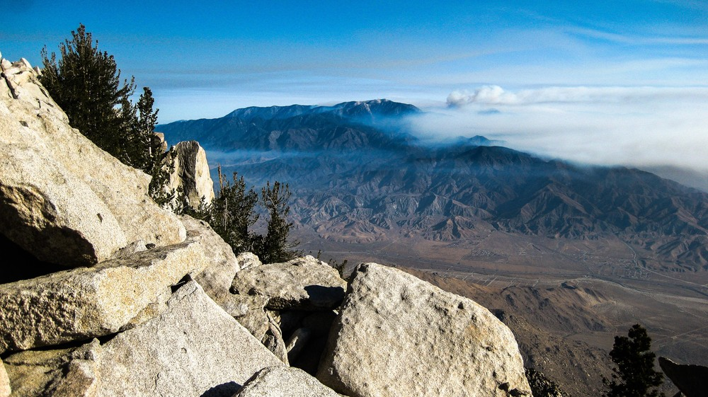 Clouds of smoke pour off of the forest surrounding Big Bear Lake, California. Mount San Jacinto State Park, California