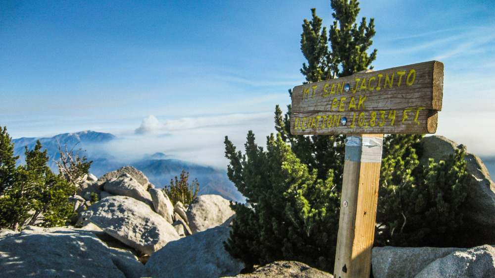 The summit of San Jacinto Peak, with Big Bear's Lake Fire burning in the background. Riverside County, California