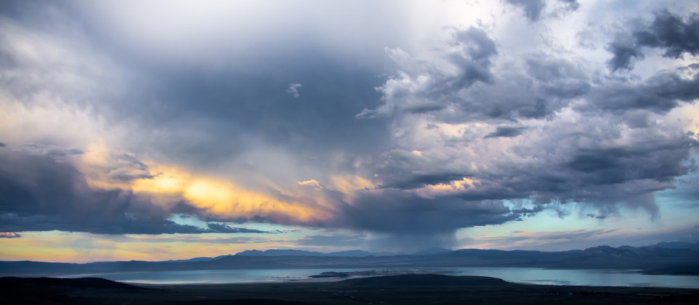 Last light strikes an incoming storm over Mono Lake. Lee Vining, California