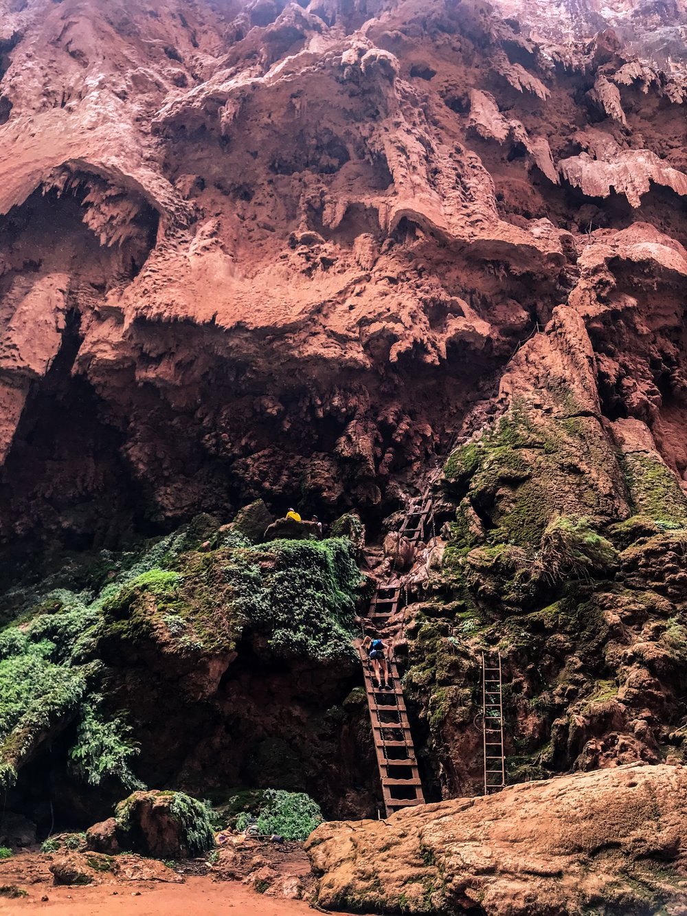 Ladders leading to the tunnel that climbs to the top of Mooney Falls. Havasupai Indian Reservation