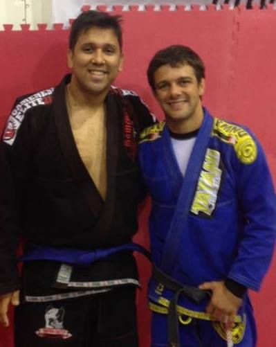 Receiving my blue belt in BJJ from Nova Uniao's Robson Moura in October 2013.