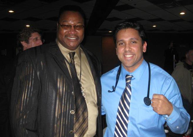 Meeting Larry Holmes at the 2012 Canadian National Amateur Boxing Championships where I was a ringside physician.