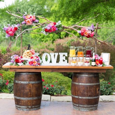 It's cold and cloudy out but this set up really brightens up my day! 🌺🌼🍹This is our wine barrel bar styled by @astylishsoireedallas and photographed by @benqphotography. #dallaswedding #rentals #theolivebench #spring