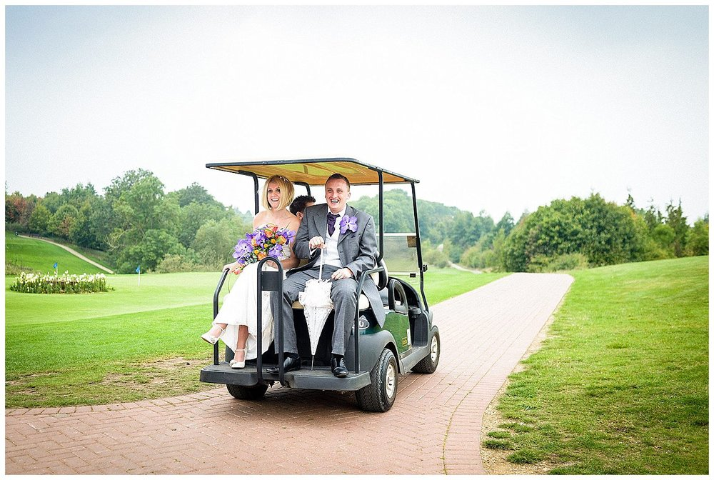 Bride and groom on golf buggy off to get some photographs