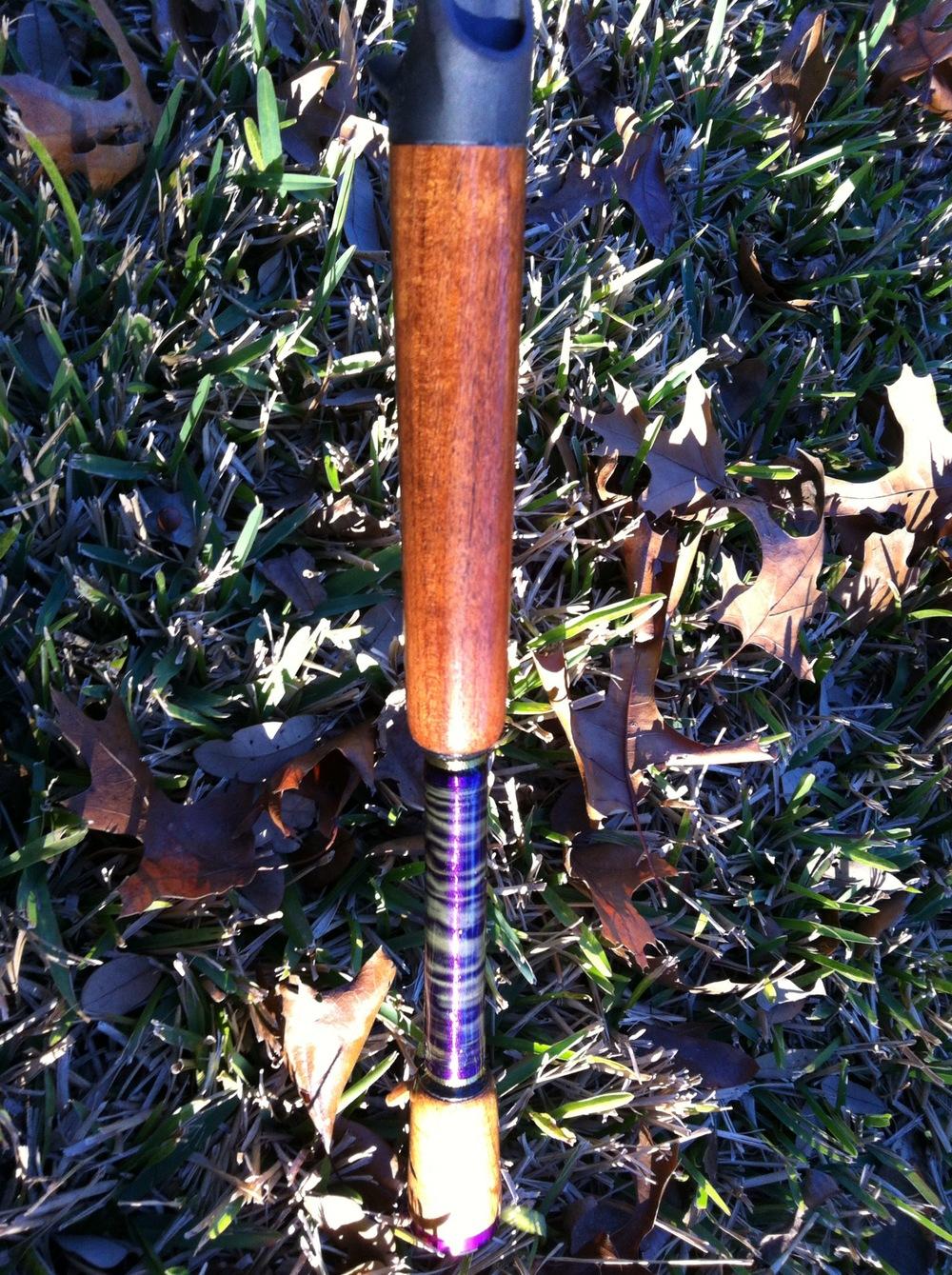 A Mesquite Wood split grip handle with purple hologram thread wrap. Very nice.