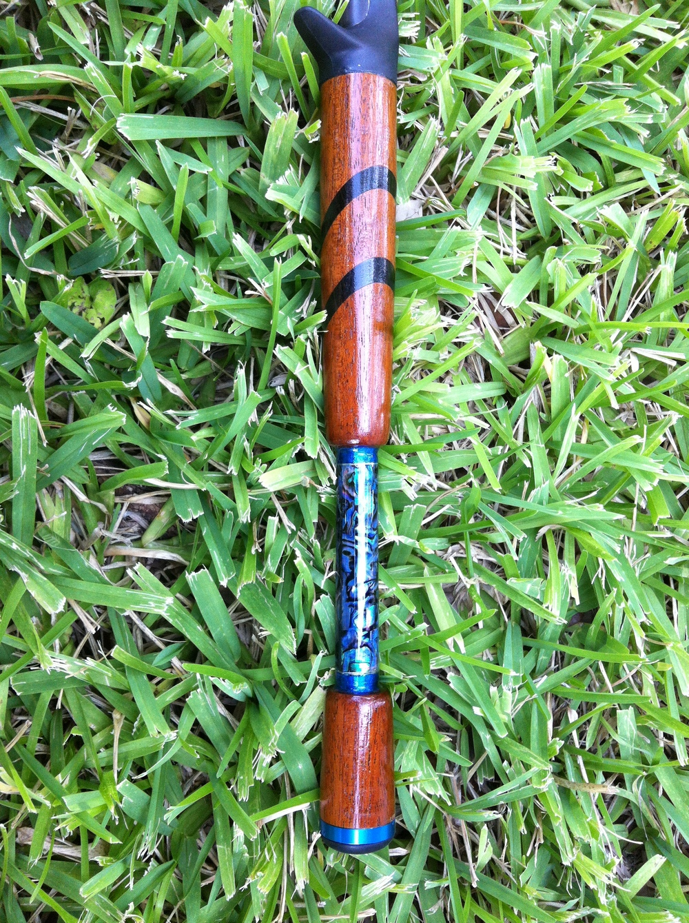 A Cherry wood handle with Abalone Shell insert.