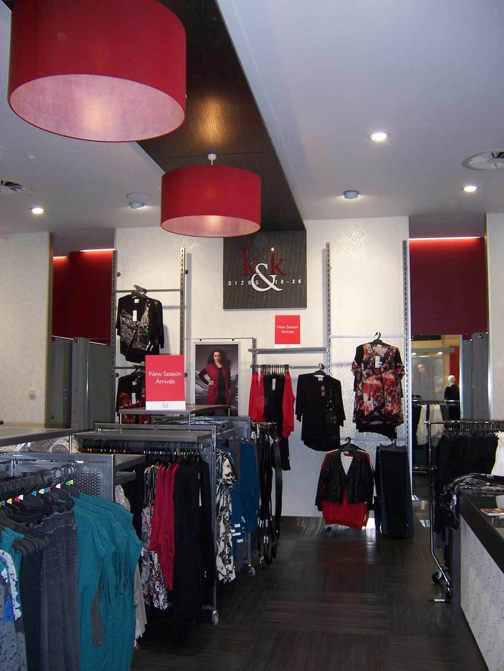 K & K Retail Interior Design Suspended Ceiling Feature Panel And Bright Red Hanging Pendants.