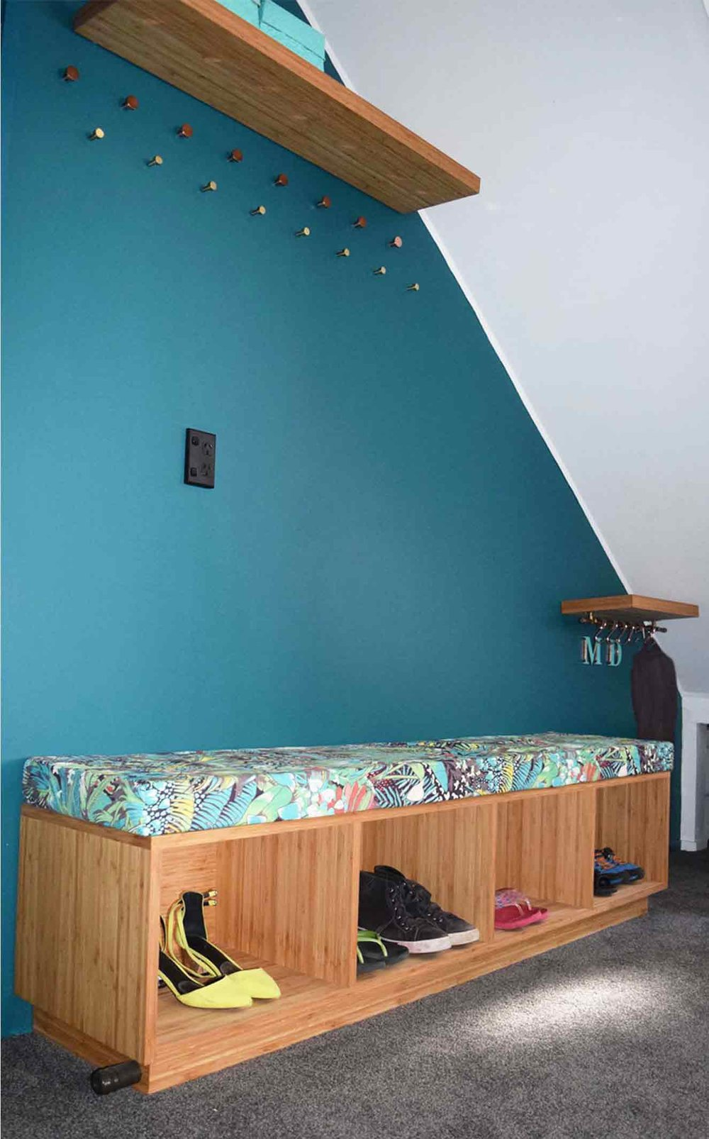 Bespoke bamboo cabinetry was made to compliment the funky retro wall and feature fabric