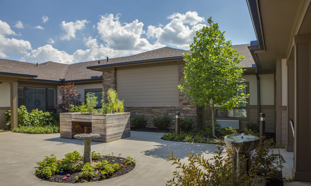 Pi Architects Meridian Knoxville TN AL MC Courtyard with flower beds.jpg