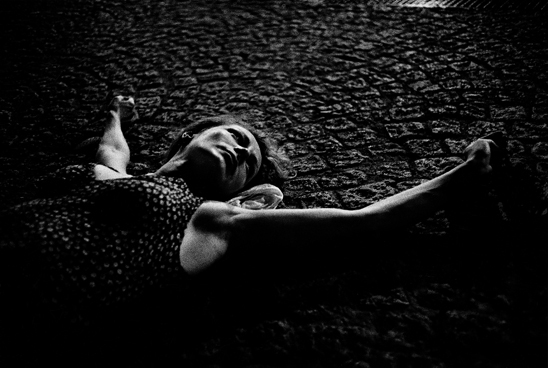 Woman lying on pavement, Paris, 2003
