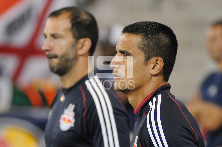 Tim Cahill warms up on the sidelines a few days after flying back from World Cup 2014 in Brazil