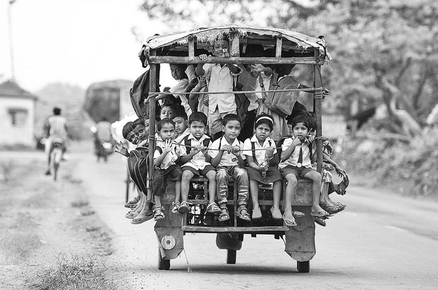 Riding a Tuktuk To School In Beldanga, India