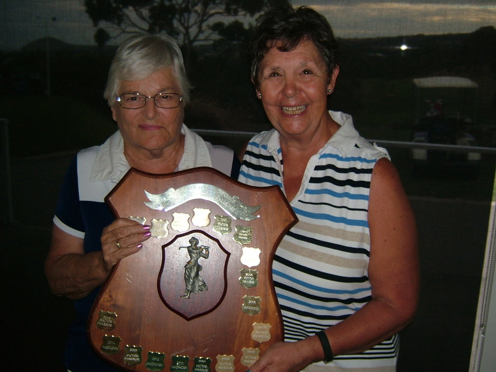 Faye WILLIS (VHGC Ladies Capt - Left) receiving the Ladies Trophy from Susan LEWIS (McCracken Ladies Capt).