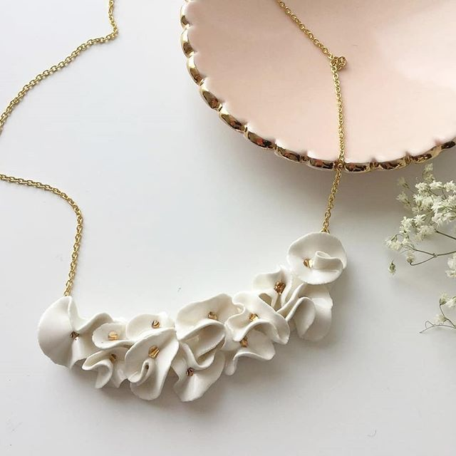 You can now find a pretty selection of Goye at @outoftheblu 😊🎀 . . . #Manitoba #canada #canadianartist #madeincanada #shoplocal #canadianceramics #handemade #ceramicnecklace #pottery #ringdish #scalloped #pastel #pink #goldeverywhere  Ring dish created in collaboration with @missnoemiah