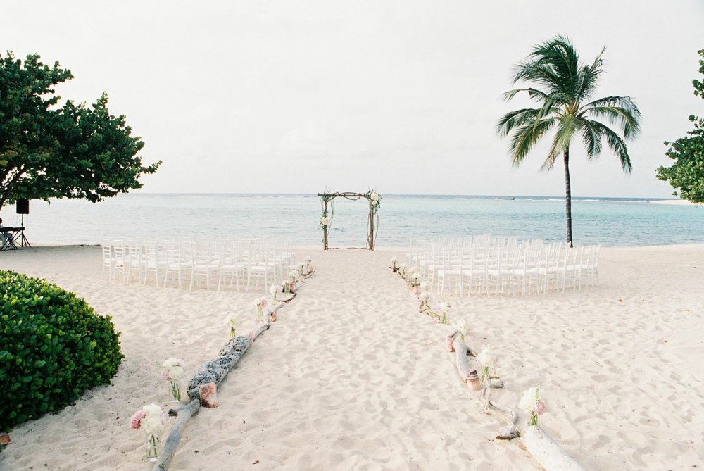 Breathtaking beach ceremony set-up. Sound system set up on the left, alter perfectly centered at the front of the subtle yet elegant aisle runner.