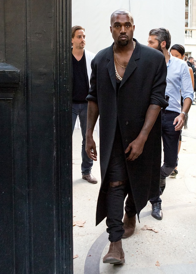 Kanye West at Paris Fashion Week September 2014. Wearing wool overcoat and Chelsea Boots ( Botegga Veneta)