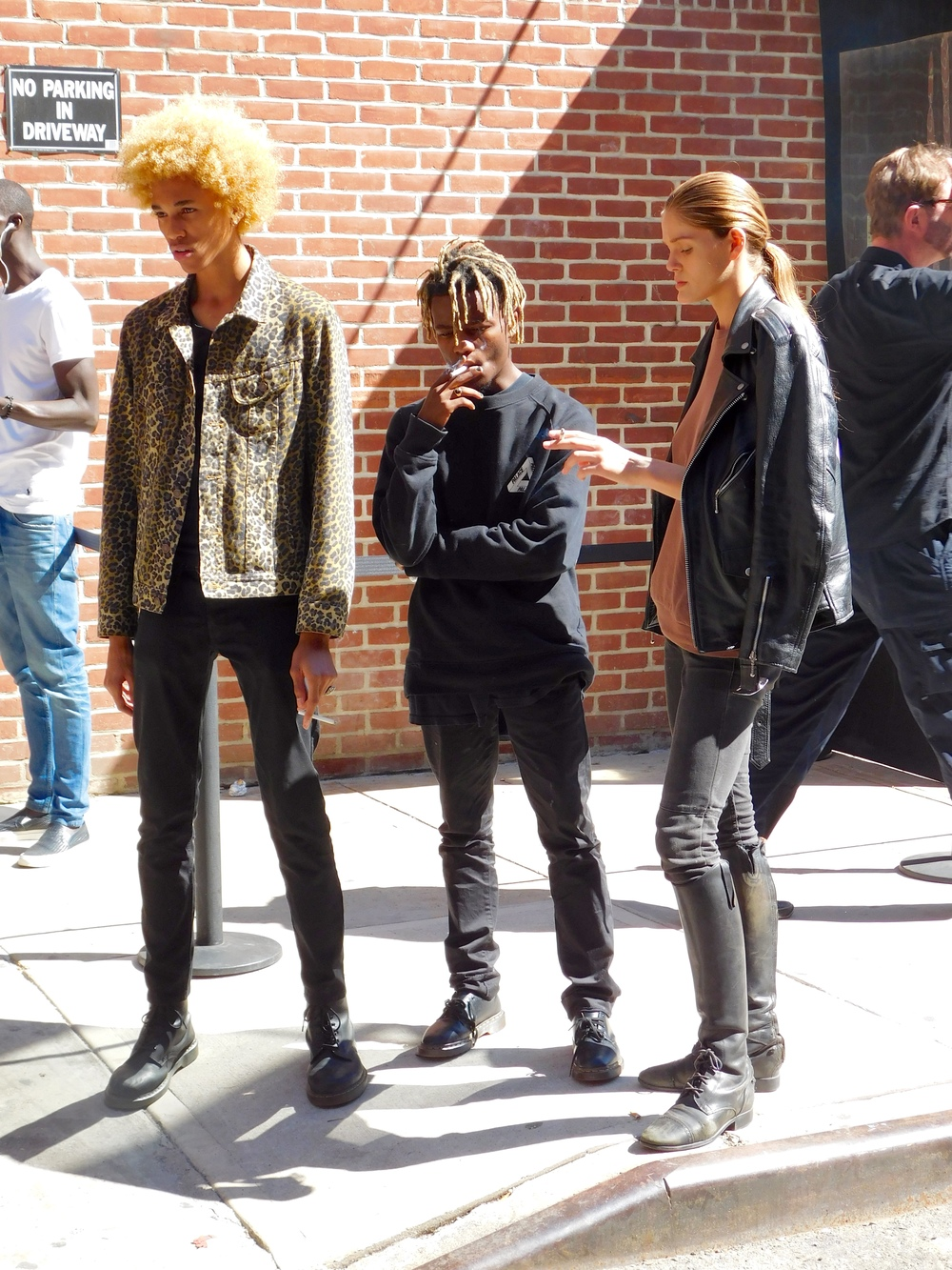Michael Lockley and Ian Connor having a smoke break before the walked in Yeezy Season 2.