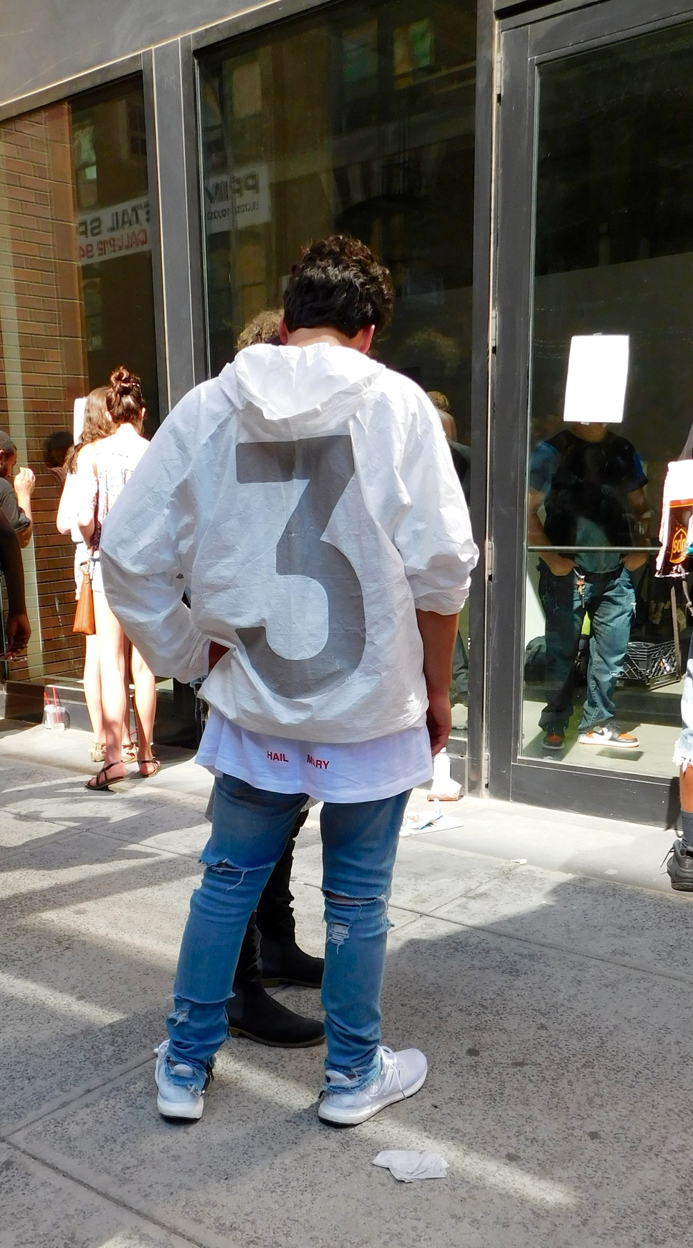 Antonio Perez wearing the Yeezy Season 1 invite.
