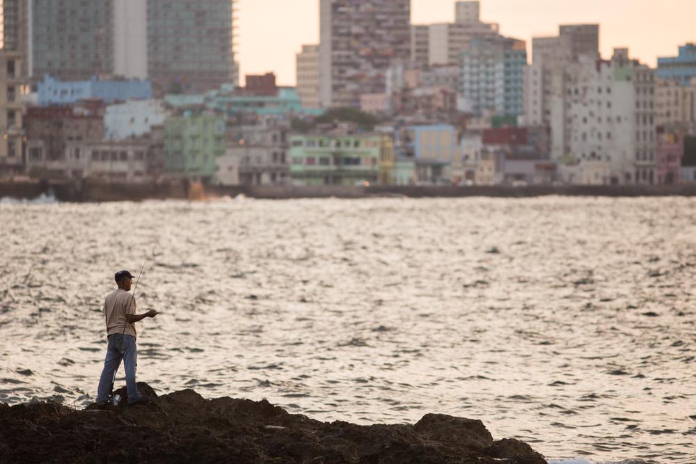 Man fishes in Havana, Cuba.