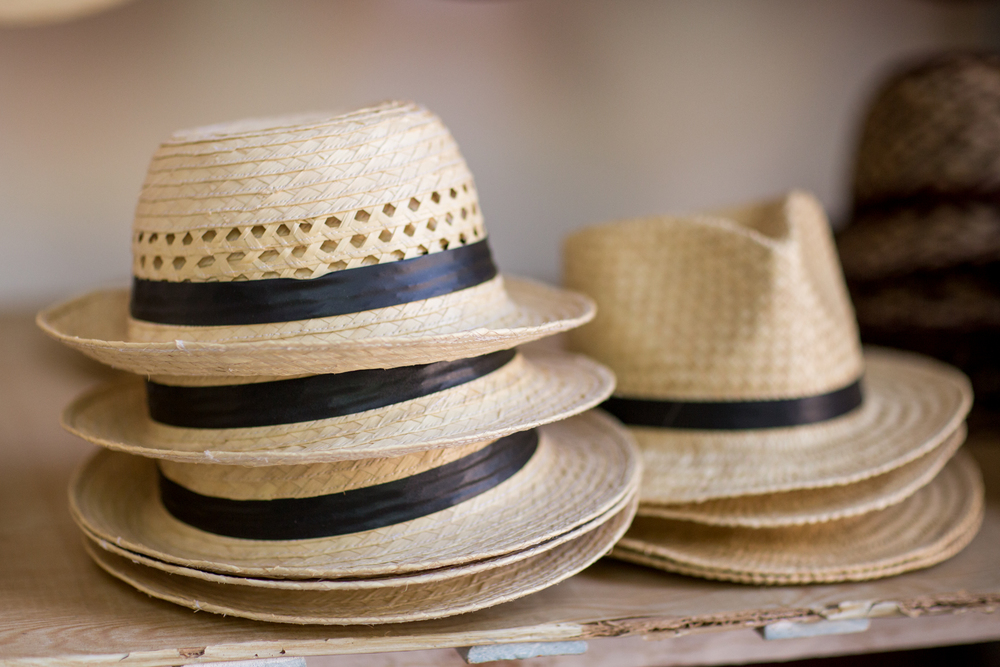 Stacks of Cuban hats with black rim.