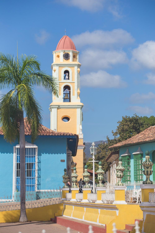 The colorful facades surrounding La Plaza Major in Trinidad, Cuba.