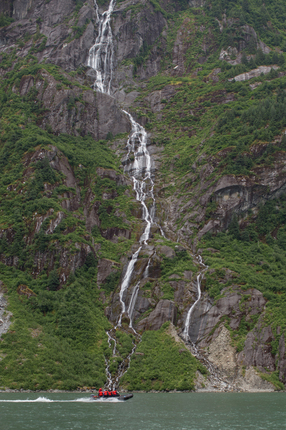 Exploring the fjords and waterfalls of Alaska's Inside Passage in small groups by zodiaks.
