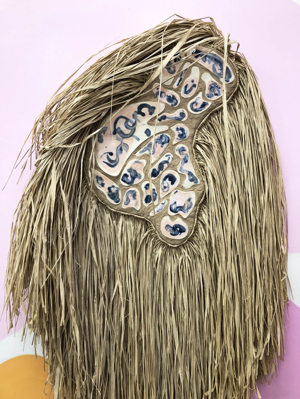 Desert Wildman I (detail)  , 2018, raffia, porcelain, sand on wood panel, 30 x 54 inches
