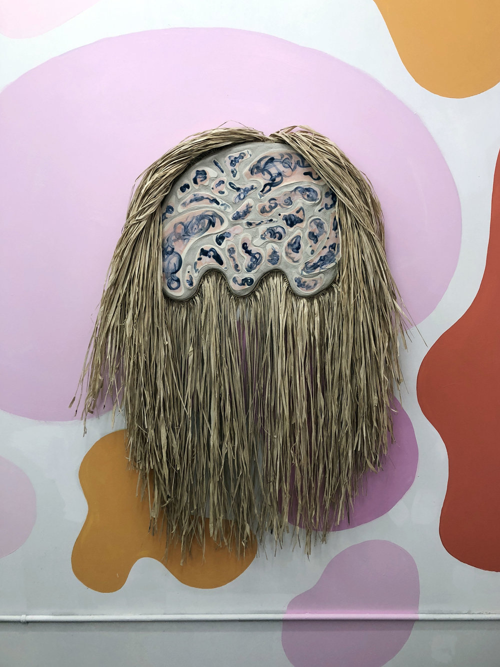 Desert Wildman II  , 2018, raffia, porcelain, sand on wood panel, 34 x 52 inches