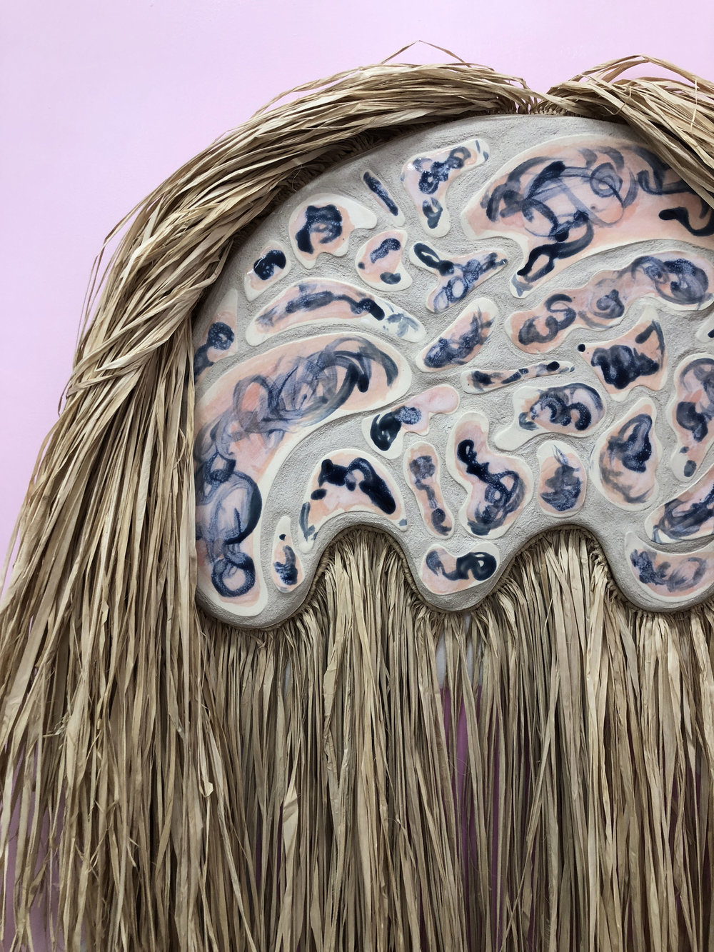 Desert Wildman II (detail)  , 2018, raffia, porcelain, sand on wood panel, 34 x 52 inches