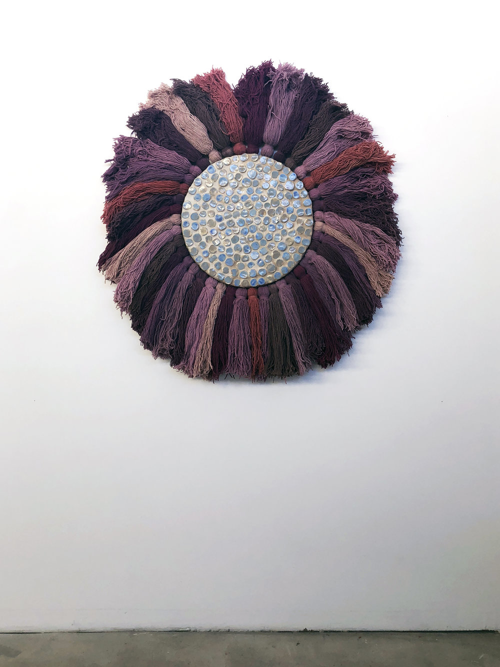 Continuum  , 2018, wool, porcelain, sand on wood panel, 46 inches in diameter