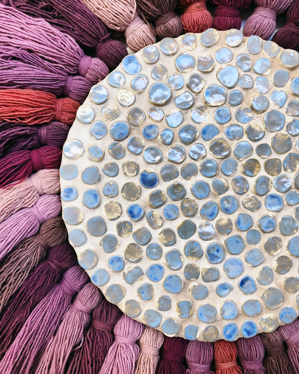 Continuum (detail)  , 2018, wool, porcelain, sand on wood panel, 46 inches in diameter