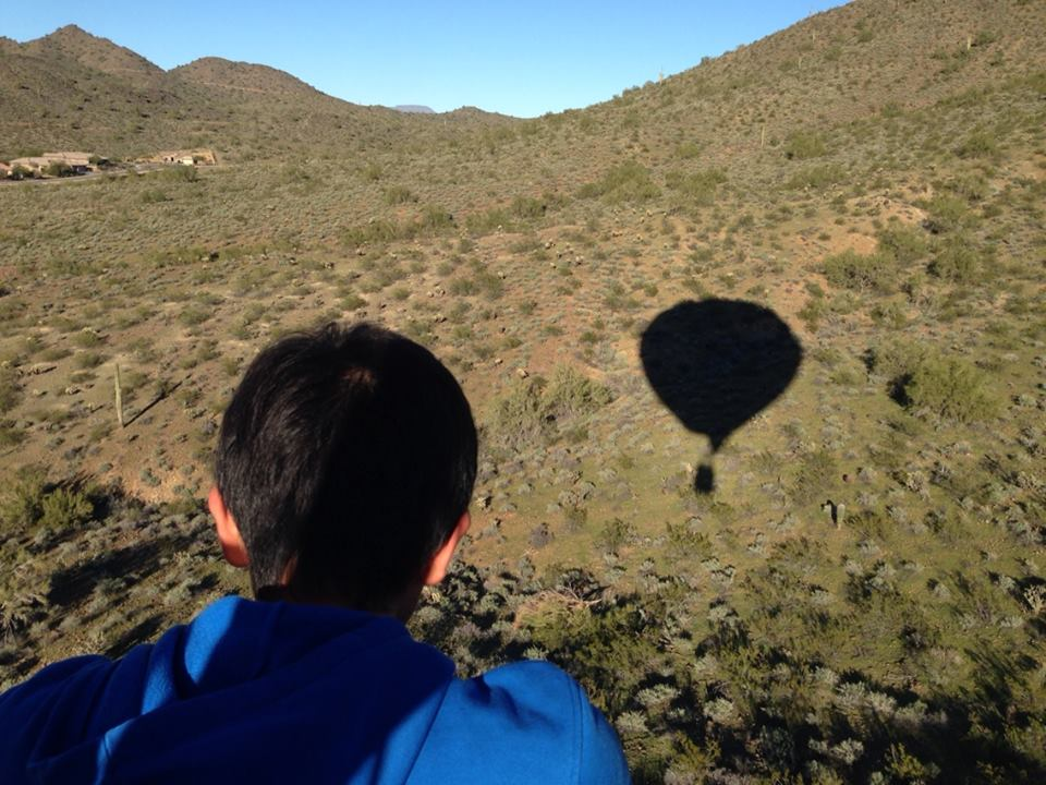 A balloon's shadow on the Phoenix landscape.