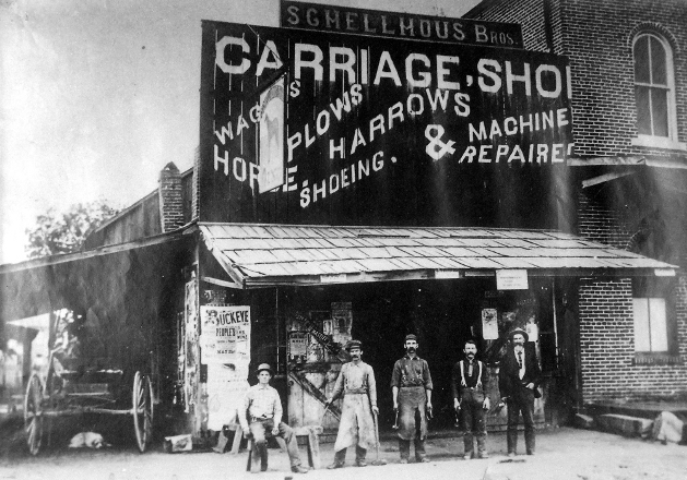 1899 blacksmith shop on Pacific Street operated by the sons of Martin Shellhous, Martin, Jr. and John, second and third from left, respectively.
