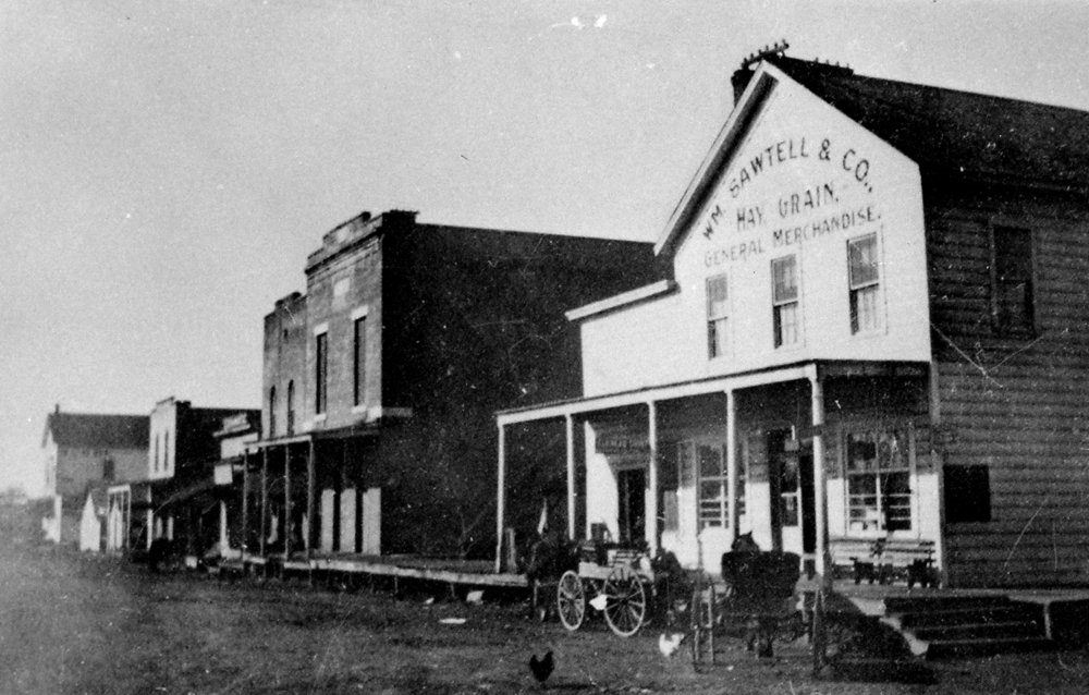 Corner of Pacific and Lincoln Streets facing the railroad tracks with the brick Odd Fellows building next door in 1905.