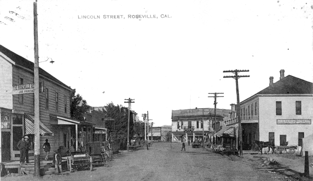 Lincoln Street at Pacific Street looking north toward McRae Building.