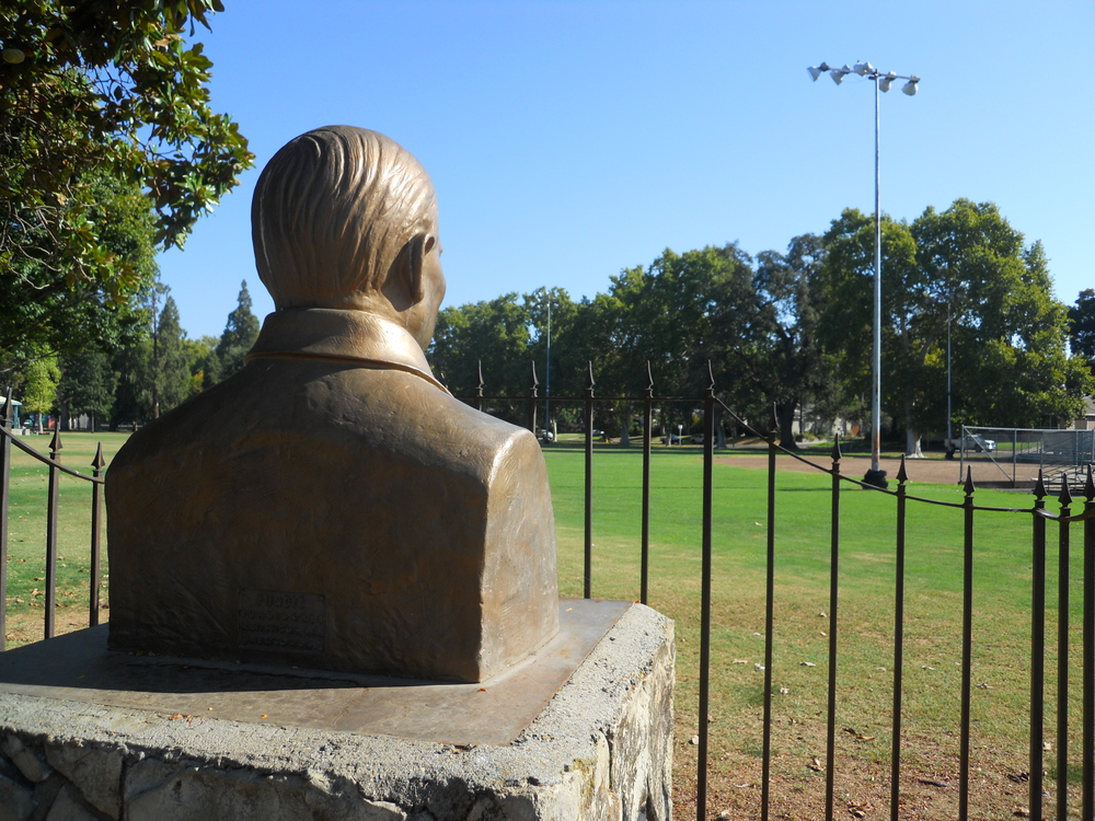 Statue of Benito Juarez keeps watch over the baseball diamond at Royer Park along Douglas Boulevard