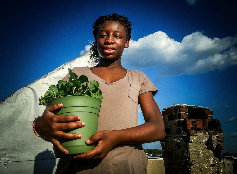 I volunteer with Big Brothers Big Sisters organization. Here is my little, Ashanti, 12, who helped me plant the strawberries and got a little strawberry plant of her own. She is great.