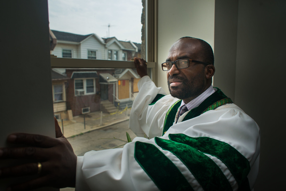 Rev. Napoleon L. Divine, pastor of Christ International Baptist Church, talks about his community's struggle after a house fire on the 6500th block of Gesner Street in South Philadelphia. He says that he disagrees with the young people's protests over firefighter's response and tries to counsel his community to stay calm until there are more answers.