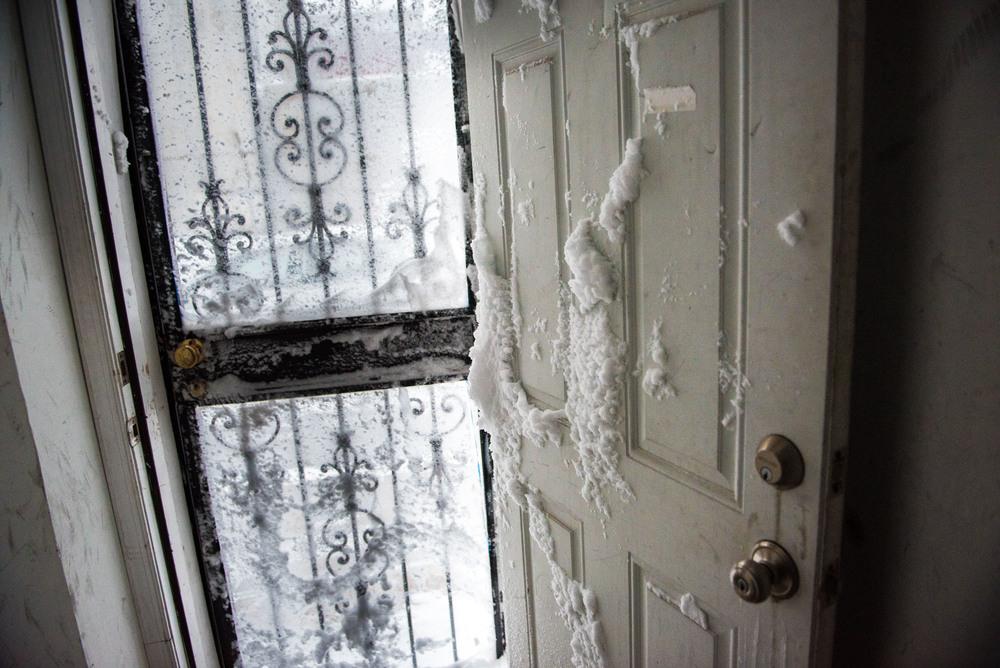 Snow that made it through a glass screen door.