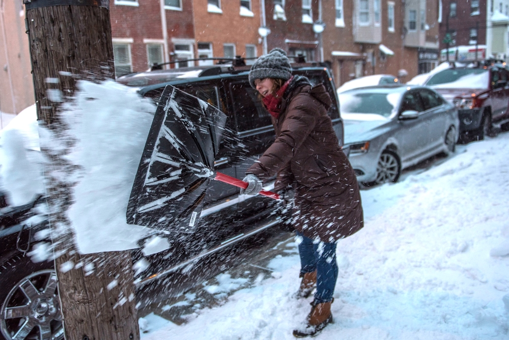 Dee cleaning her South Philly sidewalk area.