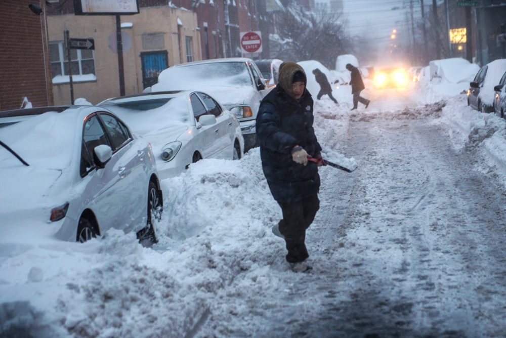 People emerged from home to begin the day-long process of shoveling out cars.