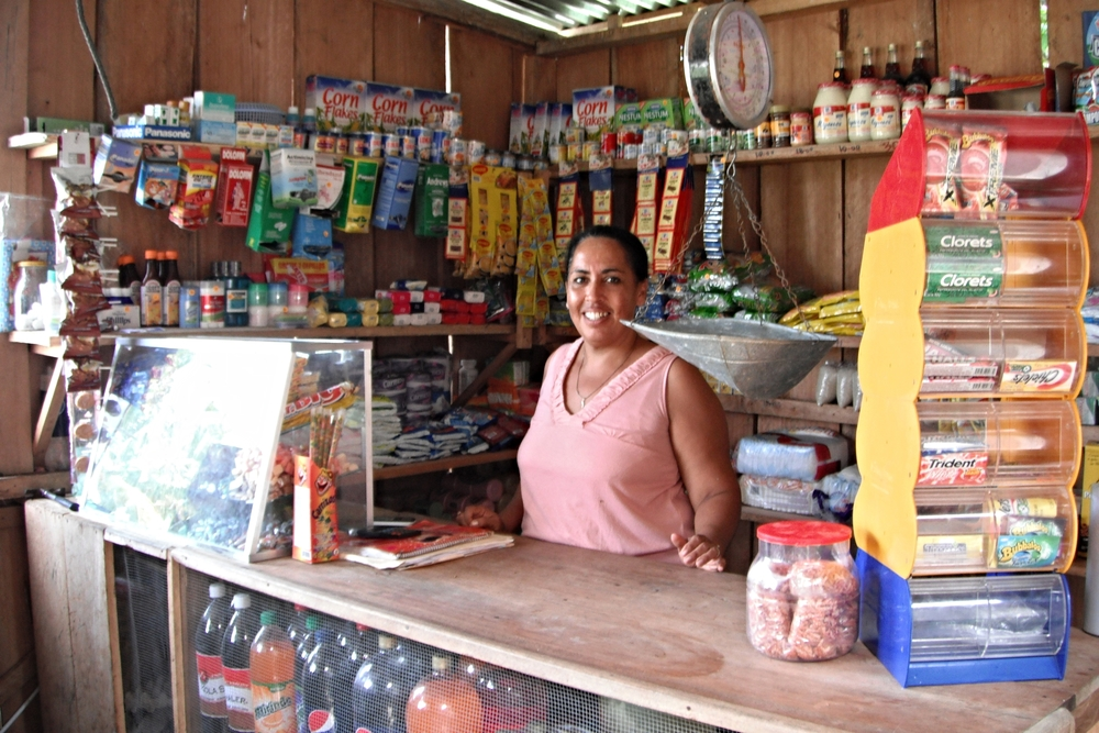 A women sells dry goods and other food and pharmaceutical items out of her small store in the town of Pearl Lagoon. She is hoping to purchase a refrigerator soon in order to serve chilled beverages.