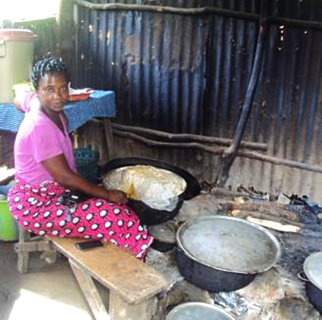Sierra Leone: A loan of $275 helps Aminata to buy rice, palm oil and containers of chicken in bulk.