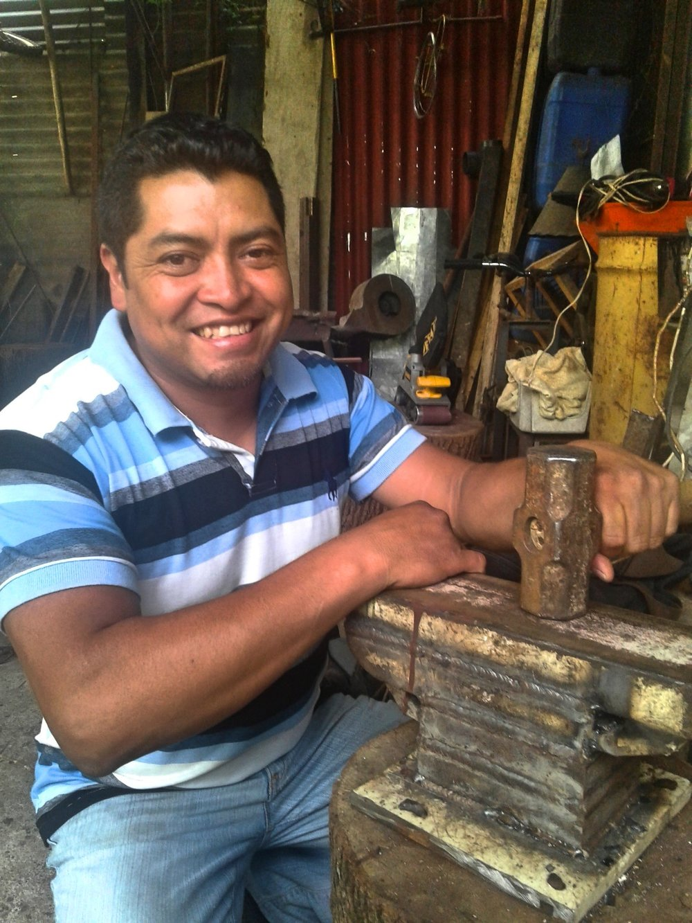 Pictured: Carlos with an anvil he purchased with funds from his recent Spartan Global loan.