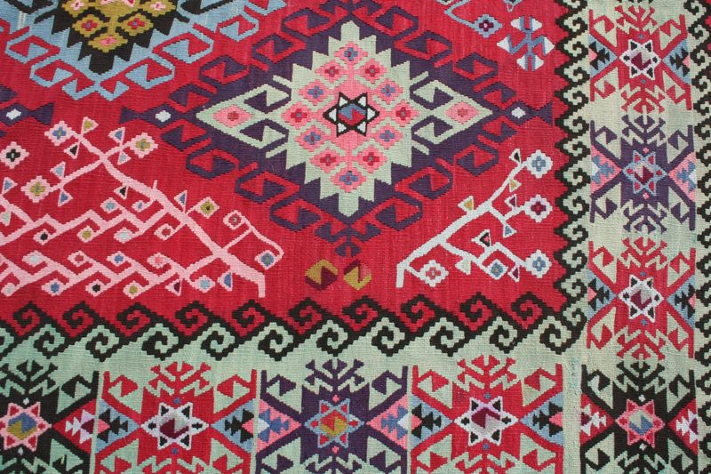 We carry both antique and new kilim rugs, all woven in Bulgaria.