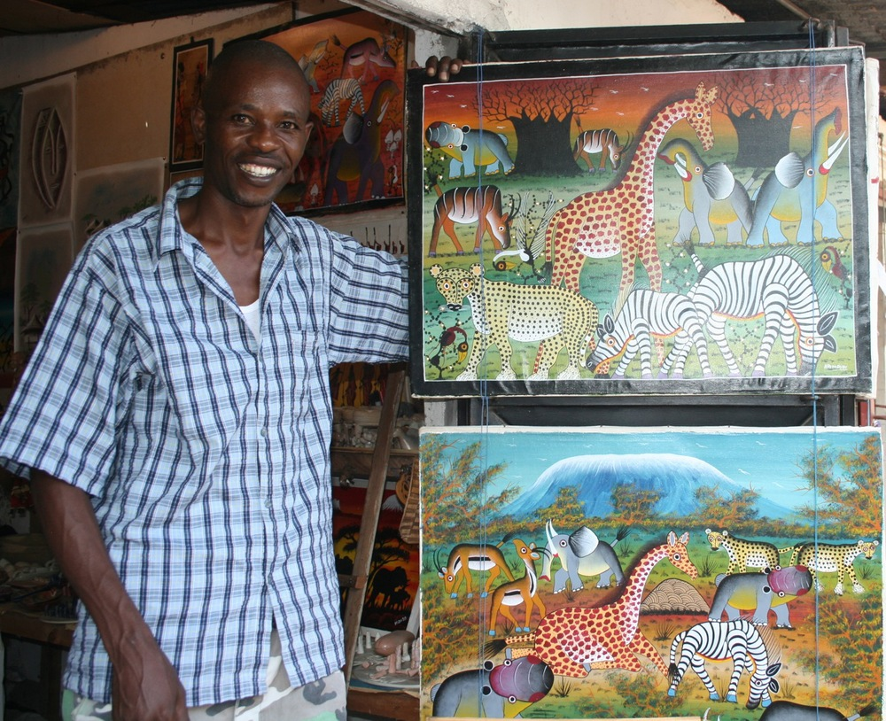 Above is one of the artists we befriended in Watamu, Kenya, a young man who created a number of tingatinga paintings. Here he is shown with pieces by Hamadi, a Tanzanian artist. .
